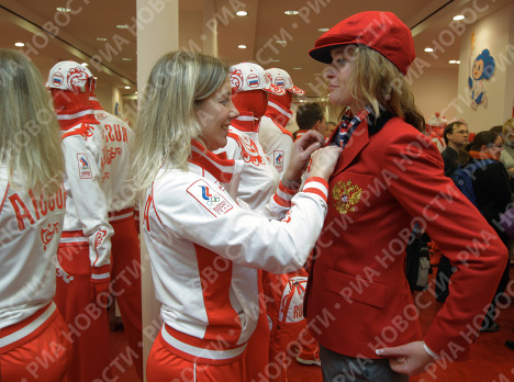 The first members of the Russian national Olympic team were presented with the official uniform for the 2010 Vancouver Olympics on Wednesday. Photo: Yelena Fomina, right, member of the Russian national women's curling team, at the opening of the BoscoSport center.