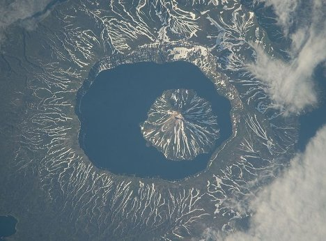 There are over 600 active volcanoes on our planet, and 28 of them are in Kamchatka, in Russia's Far East.  The Kamchatka Peninsula also has some 160 silent volcanoes. Kamchatka volcanoes are ones of the world's wonders and one of Russia's main nature attractions. On August 27-29 Kamchatka will mark Volcano Day. Three volcanoes - Klyuchevskoy, Koryak and Kronotsky - could become the volcanic symbol of Kamchatka.<br />Photo: Krenitsyn Volcano on Onekotan Island of the Kuril Islands.