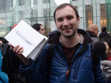 Russian Alexei Shumilov became the first person to buy two iPad 2 tablets at the New York City's flagship Apple store on Fifth Avenue after hours of waiting.<br /><br />