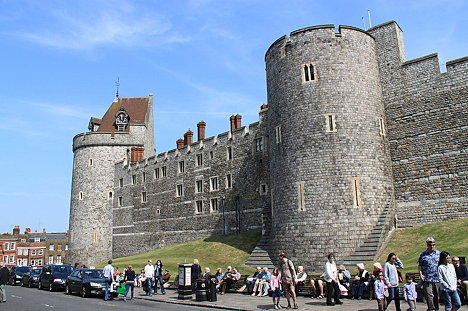 Windsor Castle is the main attraction of the town of Windsor, Berskhire, located situated 21 miles (34 km) west of central London. In the photo: Curfew Tower and a part of the Lower Ward.