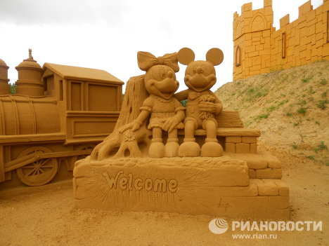 The resort town of Blankenberge, Belgium, holds the annual international sand sculpture festival. The theme of this year's festival, which will last until September 12, is Disneyland Paris. Famous Disney characters, Mickey Mouse and his friend Minnie, greet visitors at the entrance. <br /><br />