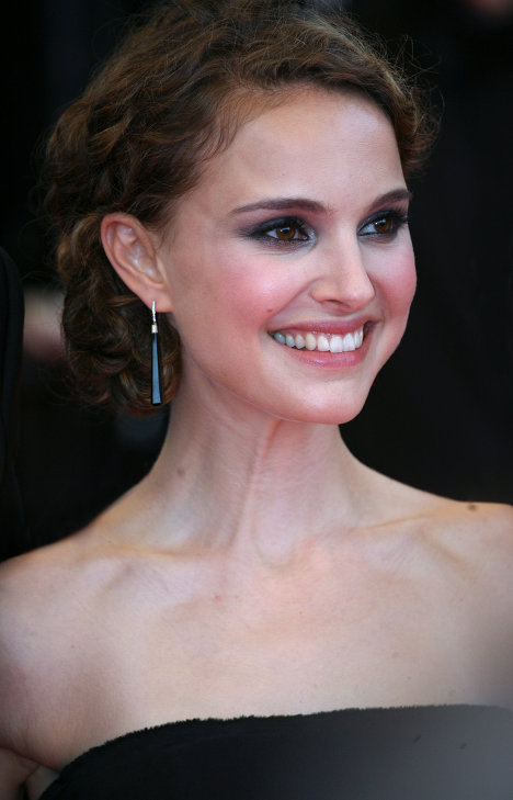 America's Natalie Portman decided in favor of vegetarianism at age 8 after she and her father attended a medical conference where a chicken was dissected in a laser surgery demonstration.