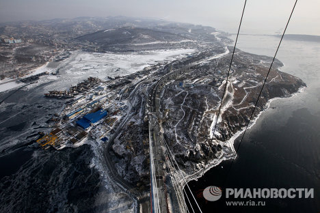 Bridges over the Eastern Bosphorus Strait and Golden Horn Bay in Vladivostok, which are being built for the APEC summit, will be handed according to terms agreed earlier, Viktor Ishayev, Presidential Envoy to the Far Eastern Federal District said at a press conference. <br />Photo: view from a pylon of the cable-stayed bridge projected to reach a height of 320 meters over the Eastern Bosphorus Strait toward Russky Island.