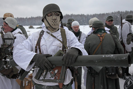 The Wehrmacht's winter-time camouflage uniforms featured a mask to ...
