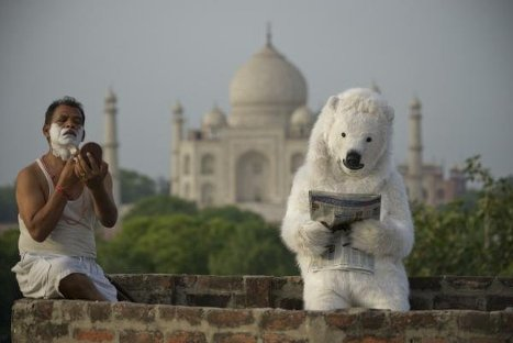 "Dressed as polar bears, Greenpeace activists across the world are rallying today to support a ""green"" call for the governments to stop subsurface resource exploration in the Arctic. In the photo: a Greenpeace campaign in India."