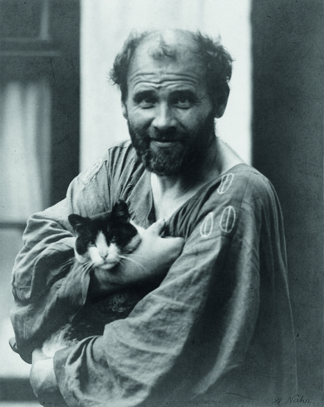 Prominent Austrian symbolist painter Gustav Klimt was born 150 years ago, on July 14, 1962. His major works include paintings, murals, sketches, and other art objects. Klimt's primary subject was the female body. <br /><br />A photographic portrait of Gusrav Klimt with his cat by Moritz Naehr. 1914