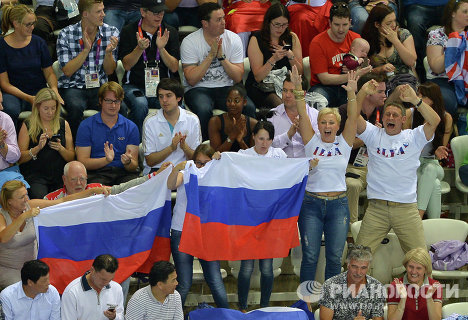 Millions of fans come to the 2012 Olympic Games in London to support their favorite teams and athletes in their victories and defeats. <br />The image features Russians greeting Ilya Zakharov and Yevgeny Kuznetsov, who won silver medals in synchronized diving <br />