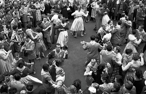 "Late 1950s: Moscow is being built-up, the first Soviet satellites have been launched, censorship of the arts is notably slackened. The ""In Moscow"" portal presents a series of image galleries on life in the Russian capital over the years. Photo:1957. Muscovites dancing in Turgenevskaya Square."