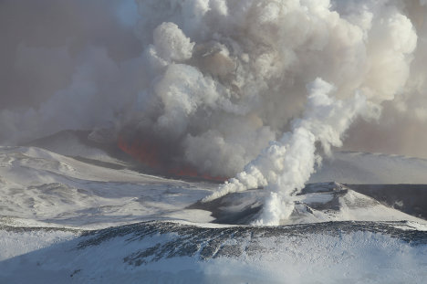 The Plosky Tolbachik Volcano on the Kamchatka Peninsula began erupting on November 27. The volcano is spewing lava from two fissures along its southern slope, according to volcanologists who inspected the mountain by helicopter. The Tolbachik Volcano consists of the Plosky (Flat) Tolbachik and the Ostry (Sharp) Tolbachik volcanoes towering 3,085 and 3,682 meters (10,119 and 12,077 feet) above sea level.