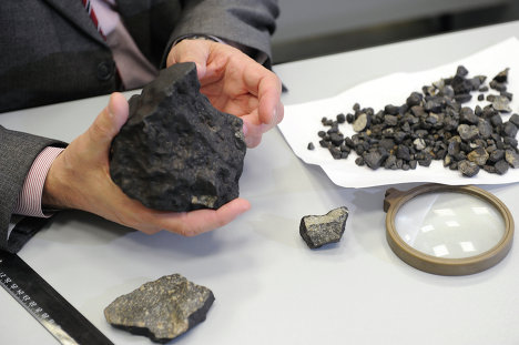 Scientists from Russia's Urals Federal University have discovered a meteorite fragment weighing more than one kilogram (2.2 lbs), the largest fragment found so far following the meteorite strike in the Chelyabinsk Region on February 15.
