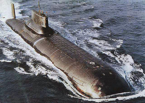 """Soviet Akula-class nuclear-powered ballistic missile submarines were first deployed in 1980. Akula-class subs are the largest submarines ever built; they are up to 175 meters in length and 23 meters wide, and are capable of accommodating a crew for many months once submerged.  Armed with a formidable nuclear missile armament and capable of hitting targets as far as 8,300 km, """"Sharks"""" can launch their long-range nuclear missiles while submerged or moored at the docks. Their ultra-quiet engines allowed them to move through NATO waters undetected.<br /><br />Above: Akula-class submarine is ready to submerge underwater."""