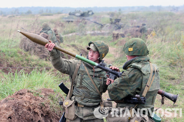 The RPG-7, a small, shoulder-launched, anti-tank, rocket-propelled grenade launcher (RPG-7) was designed by the Soviet Union to be used against enemy armored vehicles, including tanks. It's rugged and has a simple design. When combined with its relatively low cost and effectiveness, these make the RPG-7 a weapon that is used and feared around the world.<br /><br />Above: Russian soldiers testing the RPG-7 during military drills.